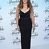 Khloé Kardashian posed for pictures on Monday at the launch of Hpnotiq Sparkle in LA.