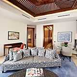 In keeping with the curvy shape of the hotel, you'll find a hexagonal ceiling and semi-circle couch in the living area, which also includes a dining area, work station and fabulous views of the shopping streets below.