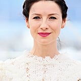 Money Monster's Caitriona Balfe paired a pink lip with a sweet, side-parted french braid.