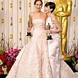 Winners Jennifer Lawrence and Anne Hathaway celebrated together in the press room.