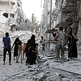A family assesses the destruction after an airstrike in Aleppo.