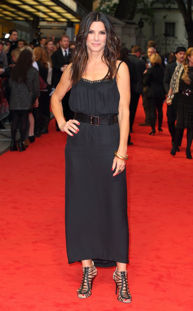 Sandra Bullock hit the red carpet for the London premiere of The Heat wearing a breezy, black maxi dress by Victoria Beckham. She gave the look a sexier spin with a belted waist and strappy cage heels. Later, off the red carpet, Sandra topped it off with a leather jacket for a cool-girl effect.