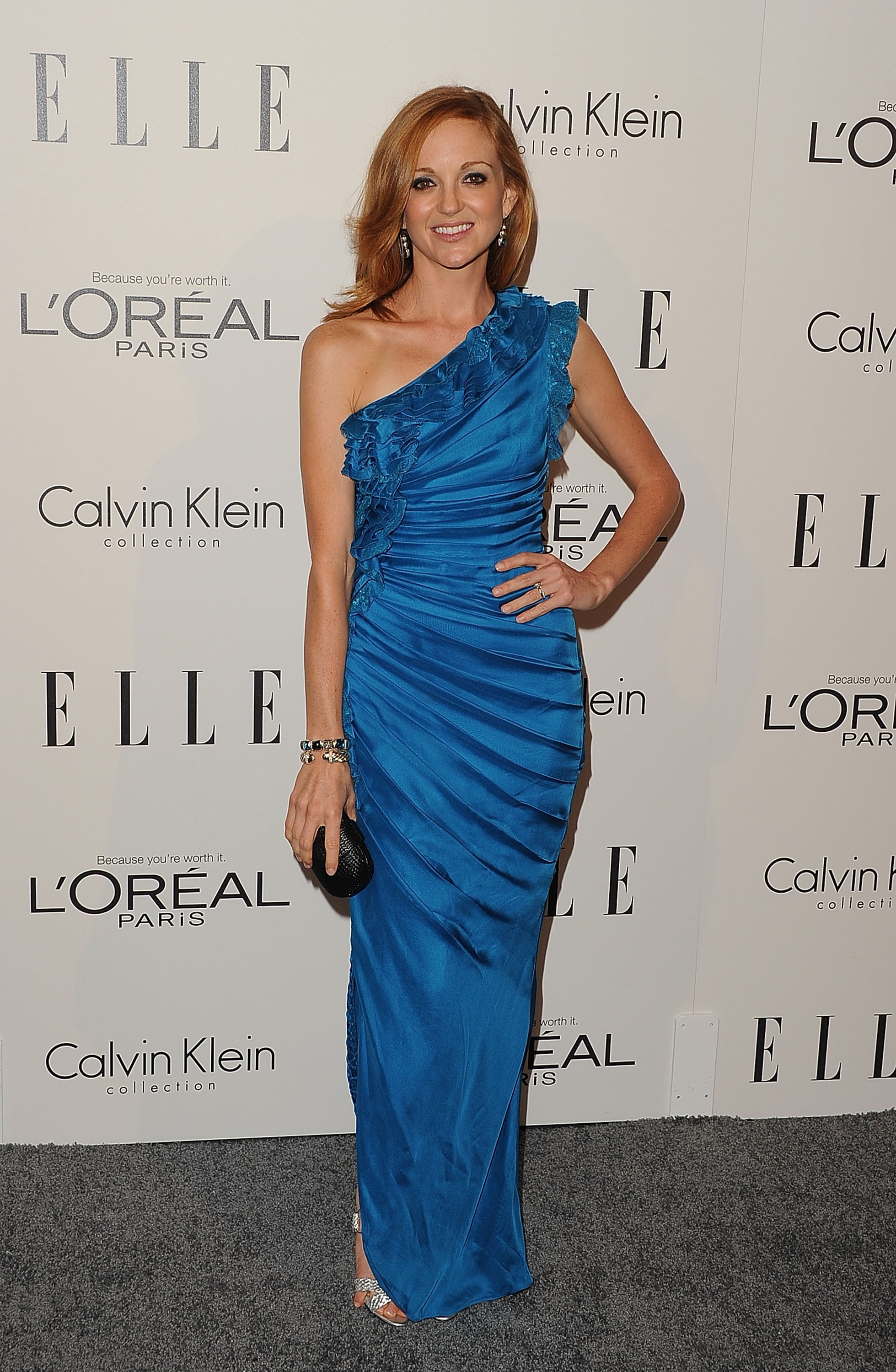 Jayma Mays in a ruffled blue dress.