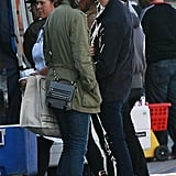 Anne Hathaway and Adam Shulman kissed by the produce at an LA farmers market in December 2009.
