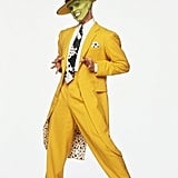 The Mask's look was definitely more polished. He paired his suit with some black and white dress shoes, a white shirt, a patterned tie, and a matching hat.