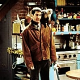 Ever the fashion-forward guy, Ross accessorises this classic suede jacket with his monkey, Marcel.