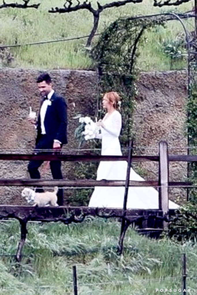 Brittany Snow and Tyler Stanaland are married! The couple celebrated their wedding on Saturday in an intimate outdoor Malibu ceremony, according to The Knot. The Pitch Perfect actress wore a gorgeous long-sleeved Jonathan Simkhai gown with a lace overlay, while Tyler, a realtor, opted for a traditional black tuxedo.  Tyler proposed to Brittany back in February 2019. Before their nuptials, Brittany celebrated with some of her Pitch Perfect pals during a fun-filled bachelorette party. Then costars Anna Camp, Kelley Jakle, and Chrissie Fit made it out to Southern California to serve as bridesmaids for the big day. Keep reading to see photos of the celebration. Congratulations to the happy couple!