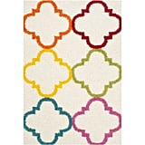 A playful take on an ultra-popular pattern, the Safavieh Kids Keeleigh Power-Loomed Shag Area Rug ($34-$184) puts repeating rainbow shapes on top of a neutral cream base.
