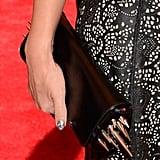 Jessica Alba brought a Christian Louboutin clutch.
