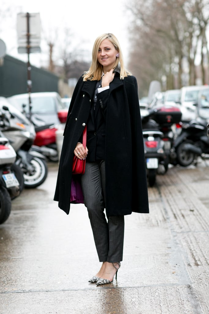 You probably already have the necessary elements in your closet — here's how to put your pumps, trousers, and elegantly draped coat all together.