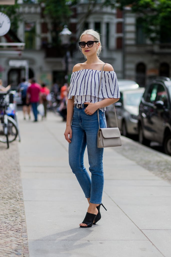 An off-the-shoulder top with jeans and heels