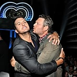 Luke Bryan narrowly avoided a kiss from Blake Shelton backstage at the iHeartRadio Music Awards.