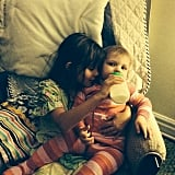 Birdie Silverstein helped her mom, Busy Philipps, out by feeding her little sister a bottle.