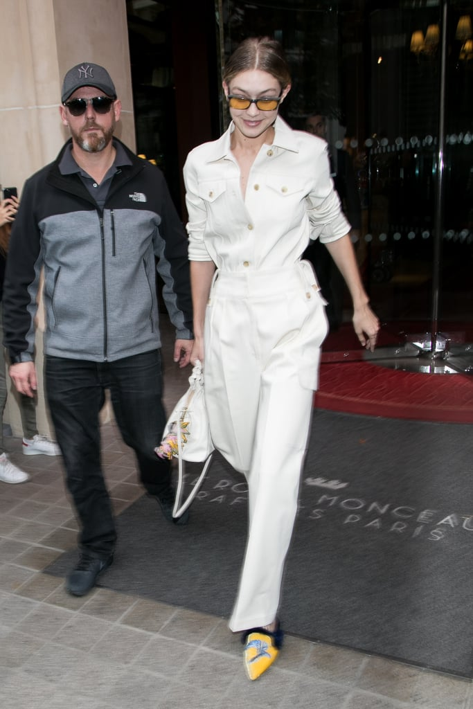 Gigi wore yet another white jumpsuit by The Row on Sept. 28, this time adding a sunny pop of yellow to the outfit. She stepped out in Alberta Ferretti bird-embroidered slides, Andy Wolf eyewear, and a bag with a Burberry charm.