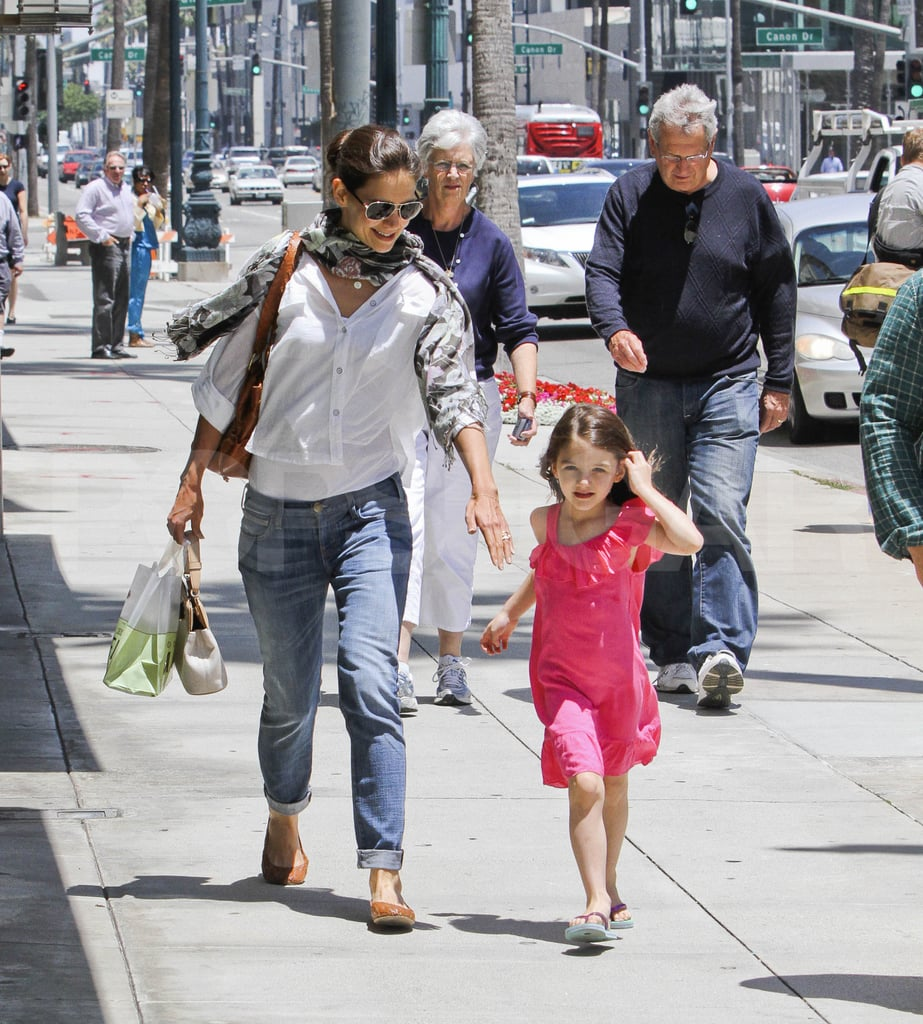 "Katie Holmes and her daughter, Suri Cruise, were together to run errands in LA yesterday. They had Katie's parents, Kathleen and Martin, along again after the foursome had lunch together Monday. Katie and Suri are hanging out on the West Coat with Tom Cruise, who was spotted spending Sunday afternoon with his family. Tom, who has been working on Rock of Ages, added another role to his long list of in-development projects. He's set to play Jack Reacher in One Shot, an action film based on a series from writer Lee Child. Jack Reacher is a 6'5"" man in the books, which had some fans wondering why 5'7"" Tom was cast. Lee, however, was happy to defend Tom, saying,  ""Reacher's size in the books is a metaphor for an unstoppable force, which Cruise portrays in his own way."""