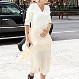 Doing zero to fan the flames of speculation, Lara Bingle kept a hand over her flat tummy on her way in to a New York medical centre.