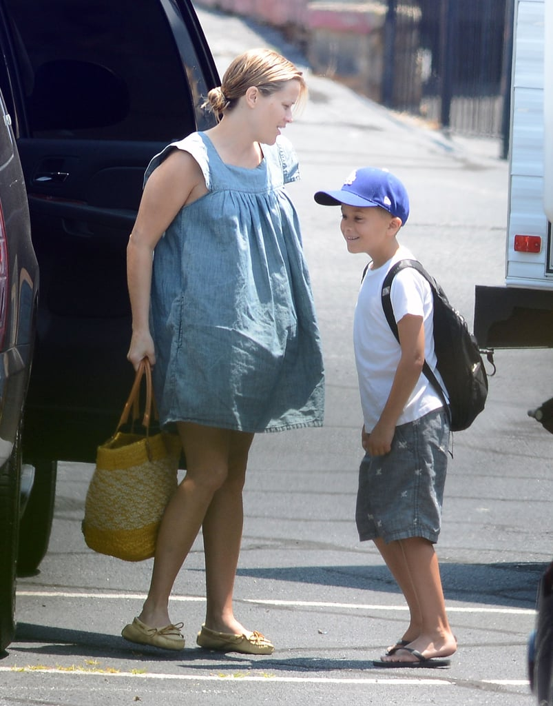 """Reese Witherspoon arrived to the set of Devil's Knot in Atlanta with her son Deacon yesterday. She covered her growing baby belly in a denim dress and carried a Balenciaga bag while Deacon represented his hometown in a Dodgers hat. Reese reported to work on her latest project after making a special appearance in Chicago over the weekend. She received the Renaissance Award honors at the Gene Siskel Film Center and chatted about her pregnancy on the red carpet. Reese said of her post-Devil's Knot plans, """"I'm going to take a little time off and go have a baby!"""" Her exciting personal life landed her on the PopSugar 100 this year, check it out to see which of your favorite stars made the list!"""