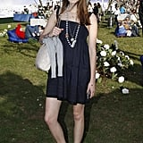 A girlie day dress meets casual kicks at a festival in '07.