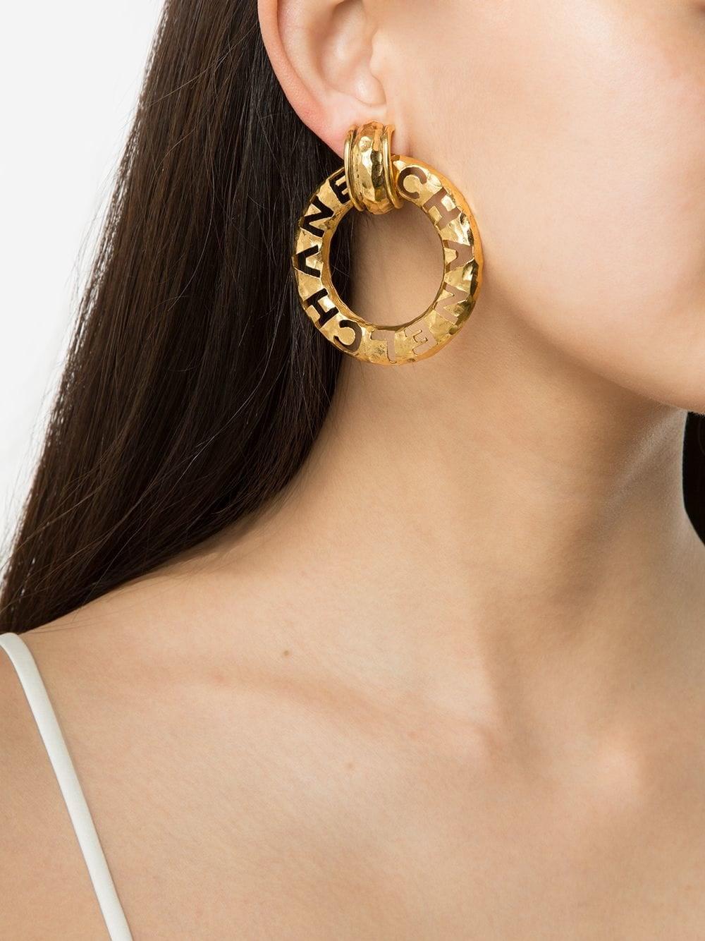 Chanel Vintage Logo Hoop Earrings  9 Stars Who We Fully Believe Sleep in  Their Gold Hoops  POPSUGAR Fashion Photo 28