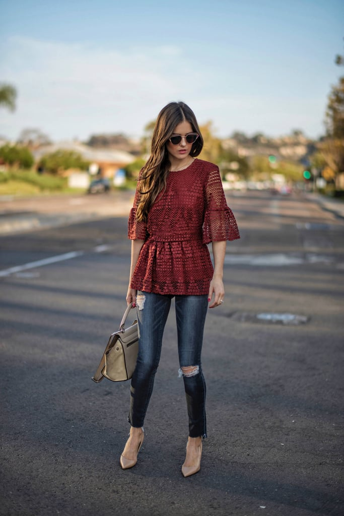 A lace peplum with destroyed jeans and beige pumps.