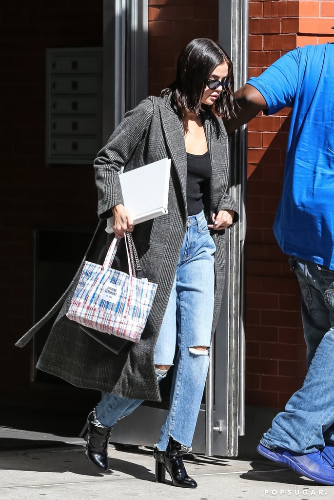 Selena Gomez Carrying a Plastic Opening Ceremony Shopper