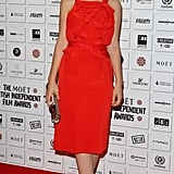 Carey earned the title of sexy sophisticate in a red Prabal Gurung sheath, embellished with a ruffled bodice, classic black peep-toes, and a tribal Roger Vivier clutch at the British Independent Film Awards in London.