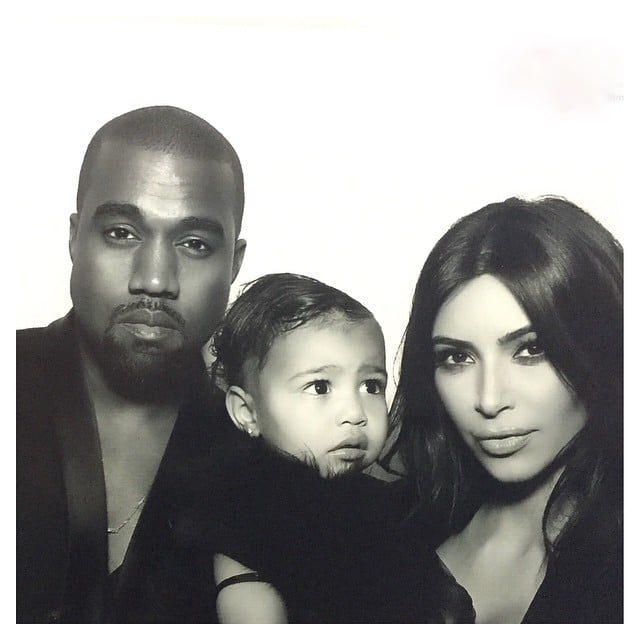 Kim Kardashian and Kanye West took a sweet photo with their daughter, North West, at Kris Jenner's holiday party.