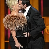 Hugh Jackman and his wife, Deborra Lee-Furness, smooched on stage during the Tonys in June.