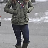 Kate matched her rainboots to a military parka and newsboy cap in the snow.