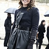 To keep her shape intact, Noomi cinched her leather-infused outerwear look with a black wide belt.