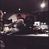 Selena sprawled out in the studio as Zedd looked like he was capturing the moment.