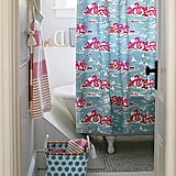 One of the easiest ways to update any bathroom is with a bold, impactful shower curtain. The Skylake Toile pattern ($68) is sure to breathe new life into a tired space.