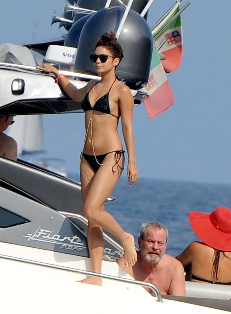 Vanessa Hudgens wore a black bikini for a day at sea in Italy.
