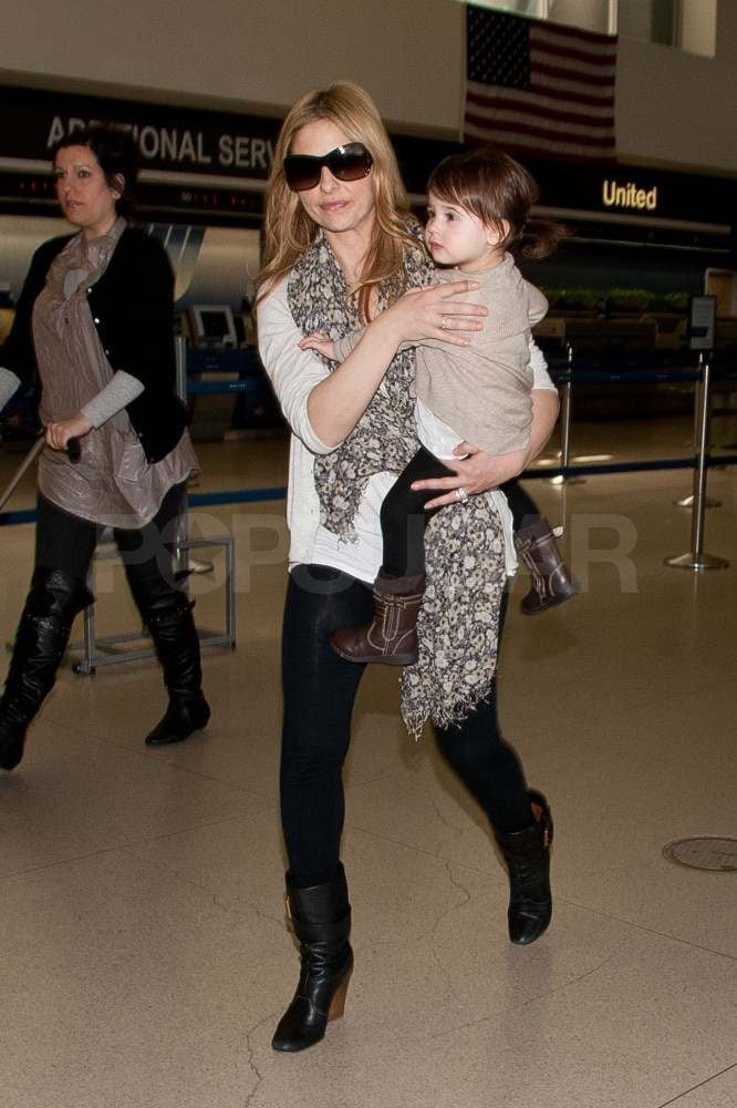 Sarah Michelle Gellar carried Charlotte Prinze through LAX yesterday. The adorable 1-and-a-half-year-old has been on the go a lot lately as she accompanies mom SMG on her travels. They've been back and forth between LA and NYC, where SMG is filming the TV pilot Ringer. She was spotted on set just last week though it looks like they're back home for now, just in time to celebrate SMG's 34th birthday on April 14.