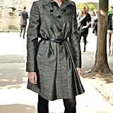Emma attended the Christian Dior Spring '08 show in a metallic coat dress and black booties.