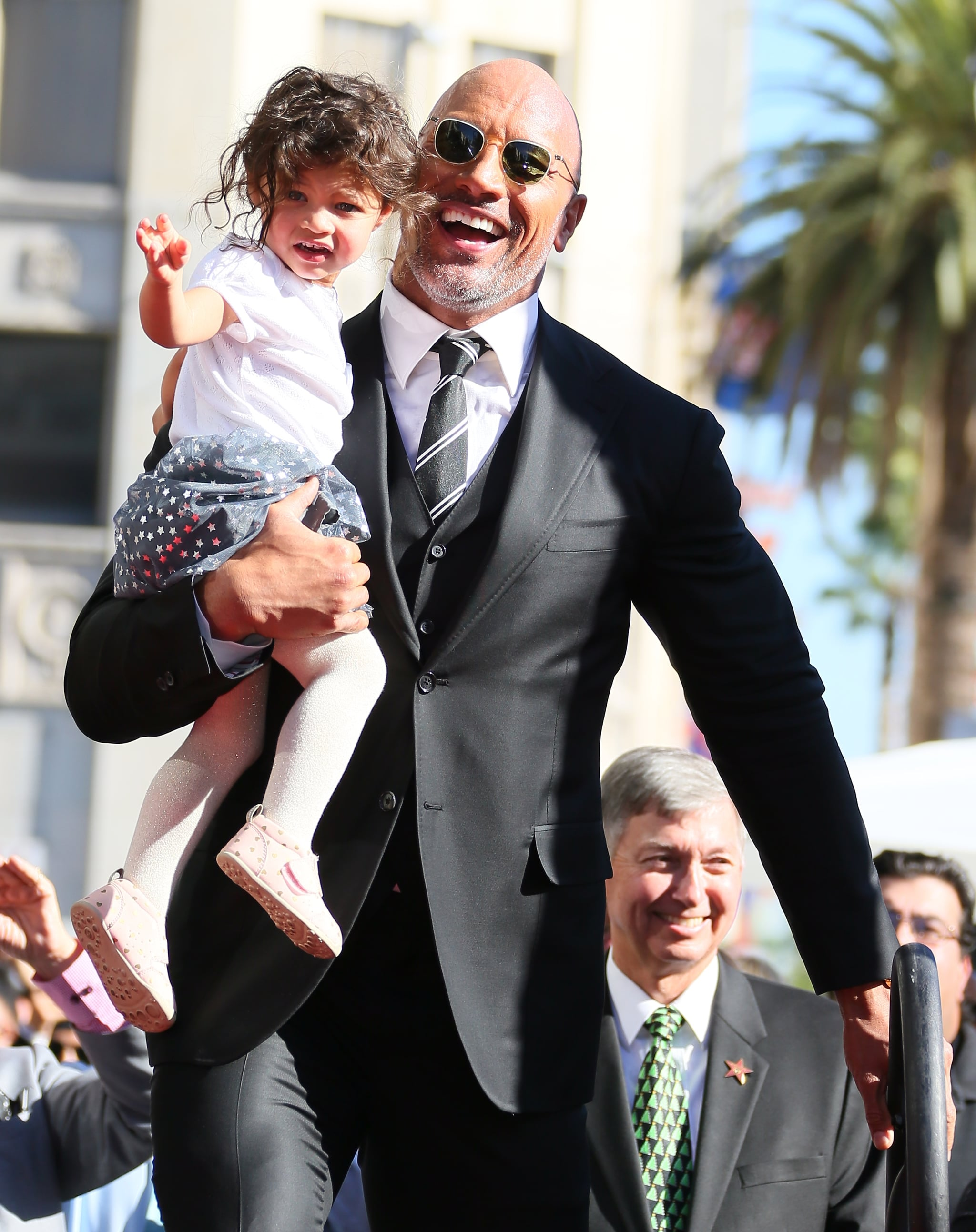 LOS ANGELES, CA - DECEMBER 13: Dwayne Johnson and daughter Jasmine Johnson attends a ceremony honouring him with a star on The Hollywood Walk of Fame on December 13, 2017 in Los Angeles, California.(Photo by JB Lacroix/ WireImage)