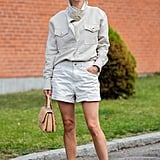 A button-down and denim shorts is the look that will forever span nearly all months of the year, with just a little extra layering power on particularly cold days.