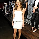 Katharine McPhee attended the Alice + Olivia Fall 2013 presentation in NYC wearing a white peplum dress by the label, complete with cool black booties.