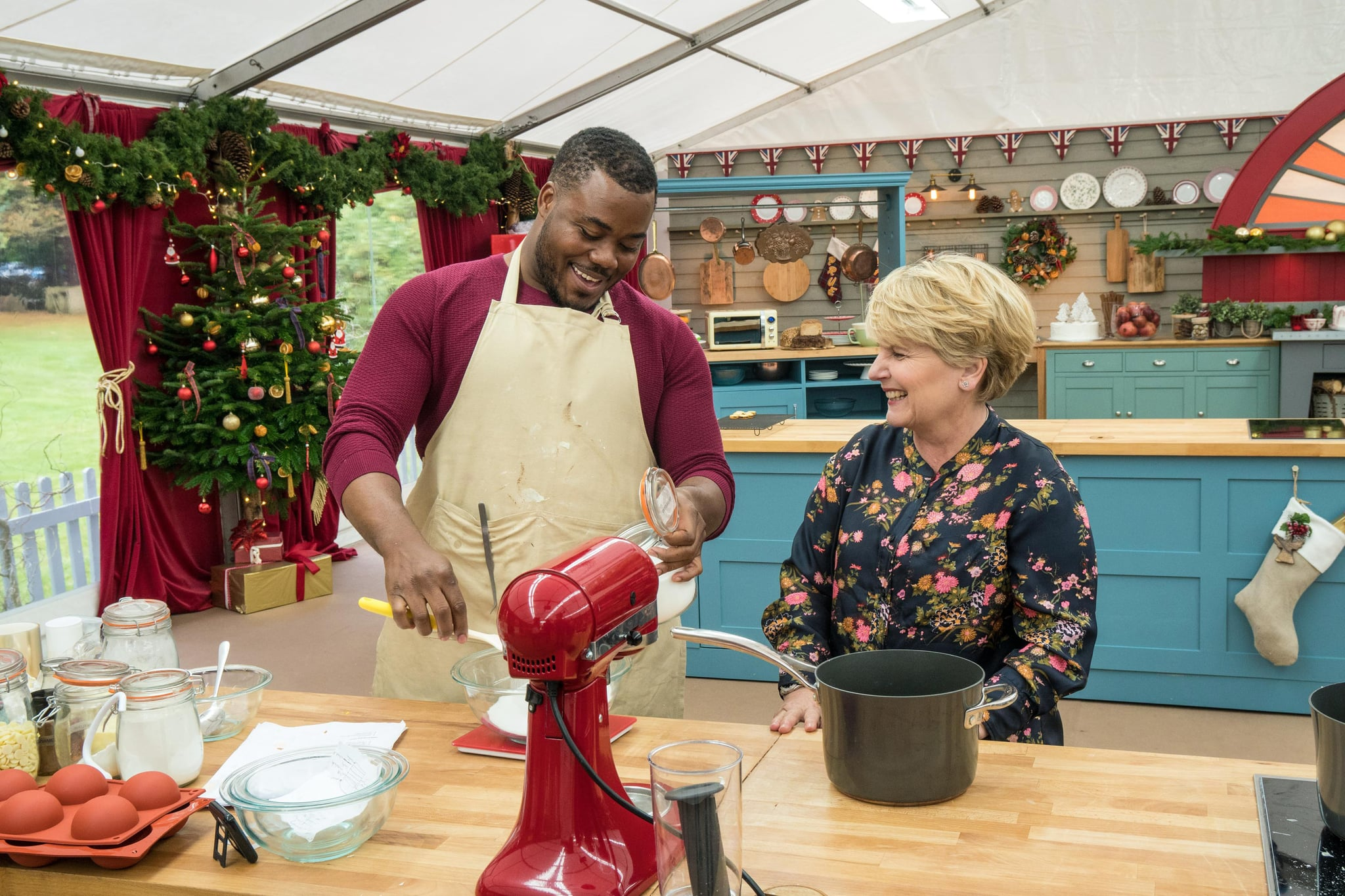 THE GREAT CHRISTMAS BAKE OFF, Baker Selasi Gbormittah, presenter Sandi Toksvig, aired December 25-26, 2017, ph: Mark Bourdillon / Charlotte Medl / Channel 4 / courtesy Everett Collection