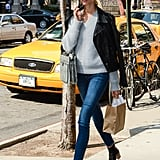Karolina Kurkova strutted her svelte stuff down the streets of NYC sporting skinny Citizens of Humanity denim with a gray v-neck sweater, a black leather biker jacket, chunky black ankle boots, finished with a navy hat and a structured bag.