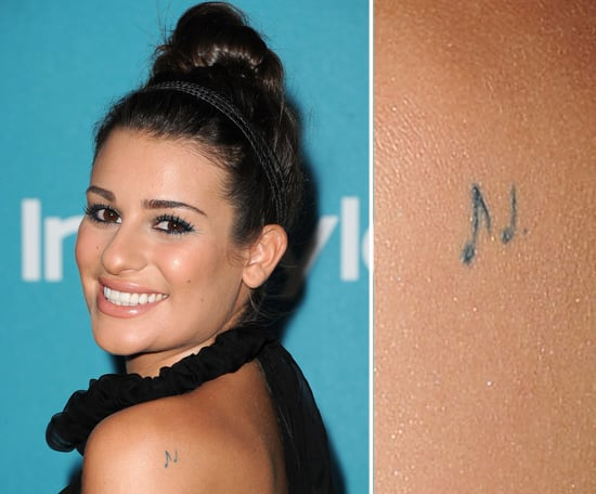 "Lea Michele has two musical notes from Queen's ""Bohemian Rhapsody"" on her left shoulder."