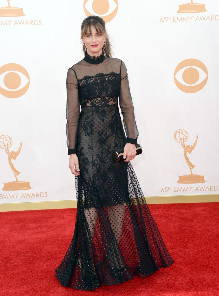 Amanda Peet's floor-length Erdem dress flashed some leg thanks to a sheer overlay.