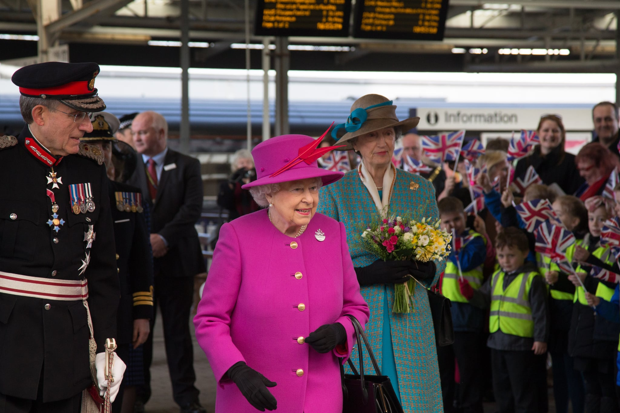 PLYMOUTH, ENGLAND - MARCH 20:  Queen Elizabeth II walks from the platform as she arrives at Plymouth Railway Station as she visits the city on March 20, 2015 in Plymouth, England.  (Photo by Matt Cardy - WPA Pool/Getty Images)