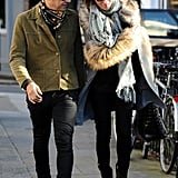 Jamie Hince wore a green jacket and printed scarf for an outing with Kate Moss in London.