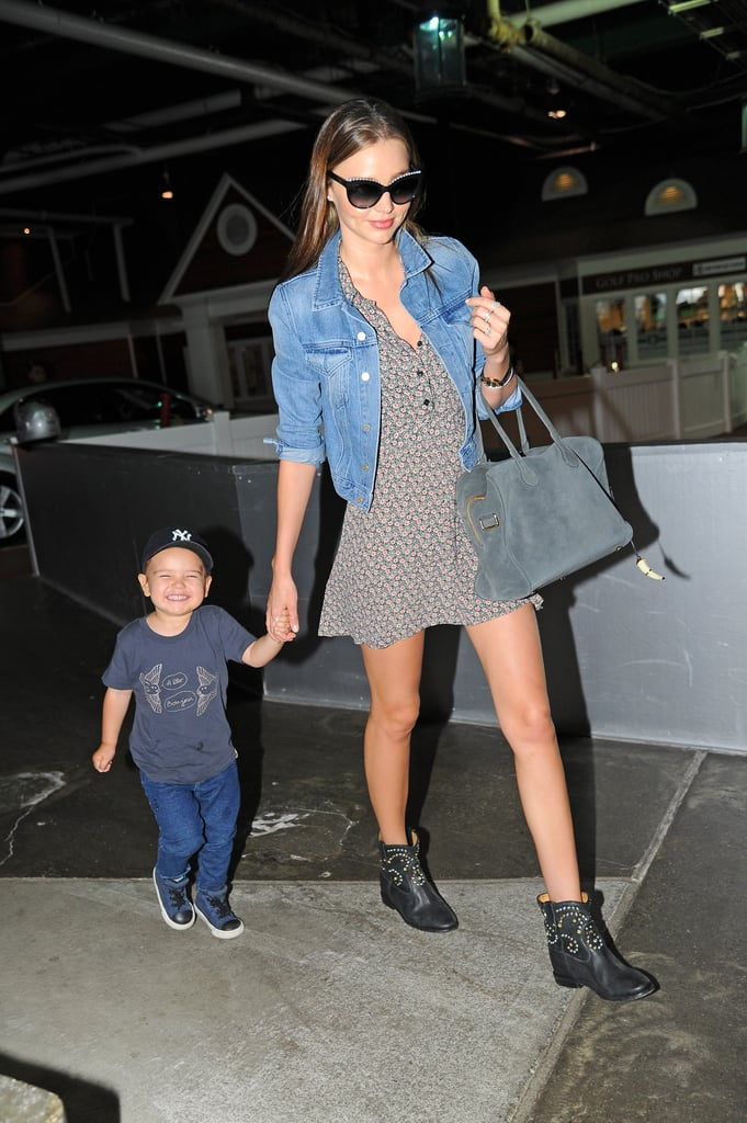 "Miranda Kerr held hands with her son Flynn Bloom on the way to a photo studio in Chelsea in NYC on Friday. The model showed off her legs in a short printed dress and boots ensemble, while two-year-old Flynn showed off his little teeth in a big, cheeky grin for photographers. He also couldn't contain his excitement when the two had a fun day out at the park on Wednesday, and in a new interview on Julia Restoin-Roitfeld's website Romy & the Bunnies, Miranda said, ""Being outside in nature — whether it's hiking, playing at the park together or even sitting under a tree reading a book,"" were her favourite things to do with Flynn. Orlando Bloom has been missing out on the family fun recently due to work commitments — last week he was in Sydney briefly to promote British Airways, and then he headed straight to New Zealand, where he's expected to be for a month to continue work on the upcoming Hobbit movies."