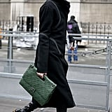 In this look, it was the accessories that made it — from the quilted emerald-green clutch to the leopard-print boots.
