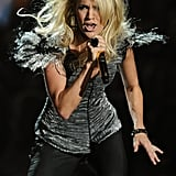 Carrie Underwood in a feather-shouldered costume — fun!