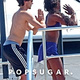 Naomi Campbell and Adrien Brody did yoga on a boat.