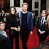 During a visit in Edinburgh, Scotland, Meghan wore a jet-black outfit under a beautiful tartan Burberry coat.