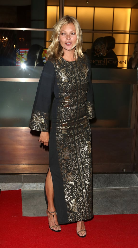 Taking a more laid-back stance on evening styling, Kate Moss attended friend Naomi Campbell's Olympic celebration dinner in a vintage gold-embossed tunic and Gucci T-strap sandals. The look gets its formal edge via gilded details, but on the whole, you could easily take this look on vacation, too.